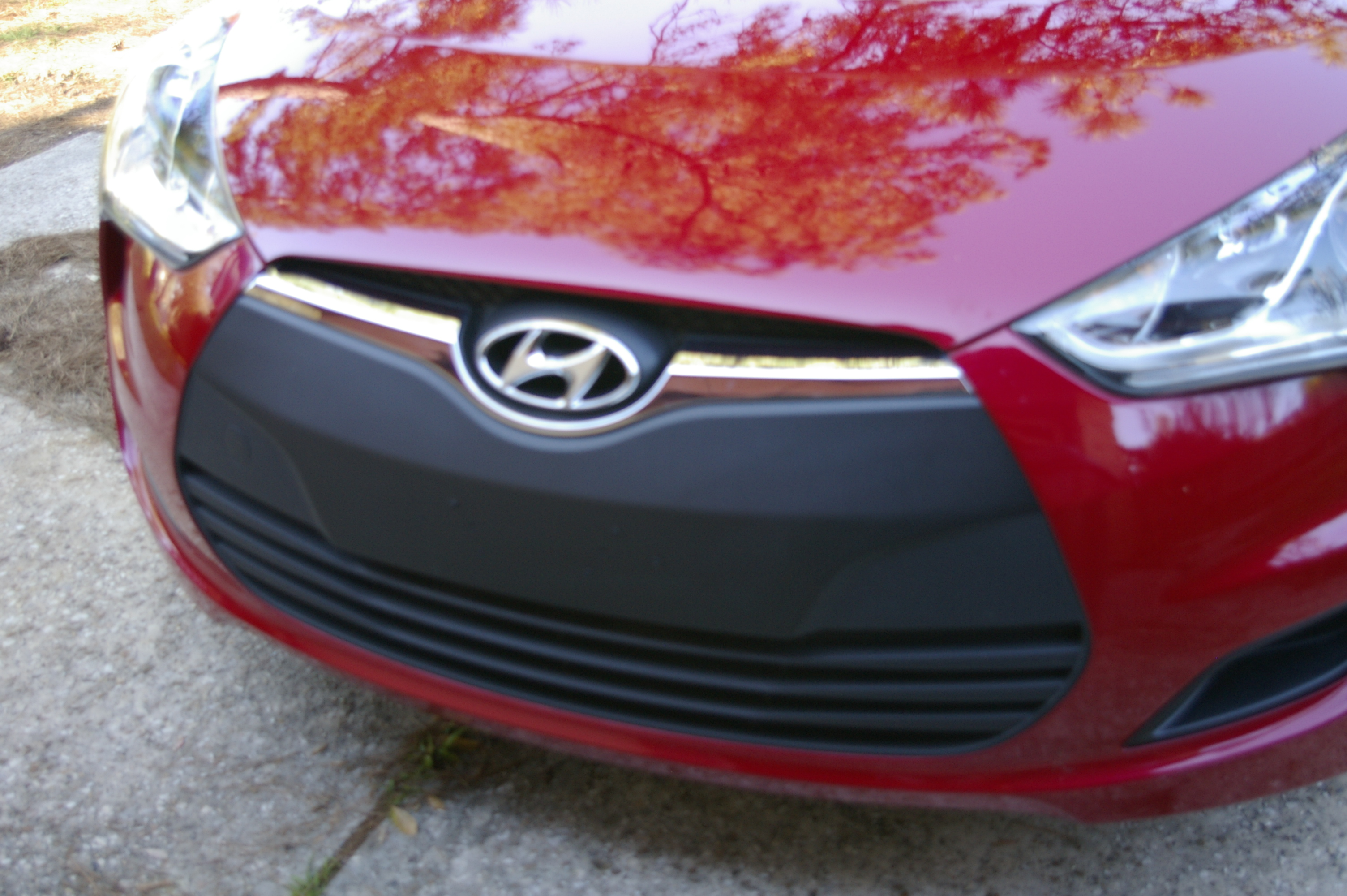 Blacked Out Front Grill On Red Veloster